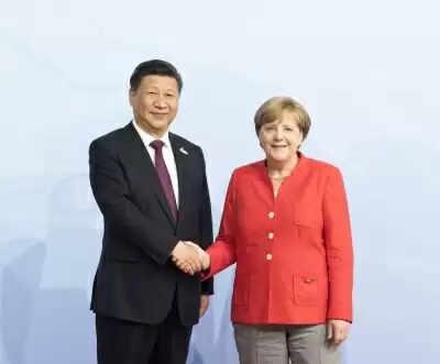 Xi, Merkel ने संबंधों, बहुपक्षीय सहयोग पर बात की
